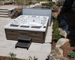 Kingston hot tub from Sundance Spas installed in a backyard space.