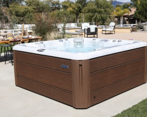 Outdoor hot tub installation on a concrete slab.