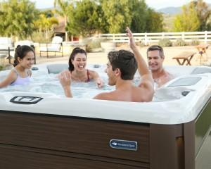 Family enjoying a Sundance Spas hot tub.
