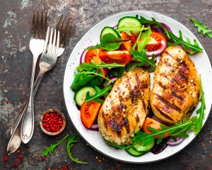 Healthy meal of chicken and salad.
