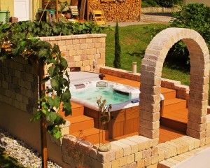 Beautiful and sunny outdoor hot tub installation.