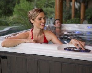 Woman and man relaxing in the hot tub.