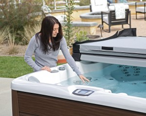 Woman feeling the water in her hot tub.