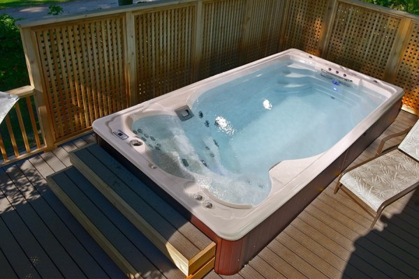 SwimLife Swim Spa installation on a deck.